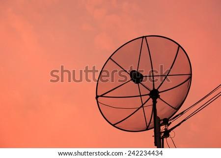 Satellite dish at sunset  - stock photo