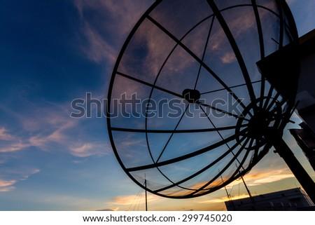 Satellite dish at twilight time - stock photo