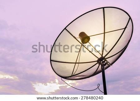 Satellite dish communication technology network at sunset. - stock photo