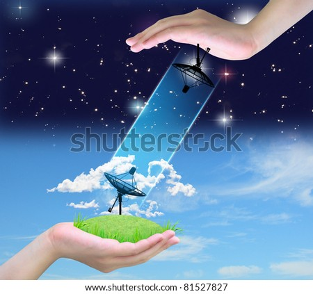 satellite dish connect in women hand - stock photo