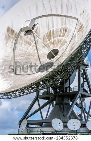 Satellite dish for intercontinental telecommunications and Internet traffic - stock photo