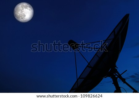 Satellite dish in evening sky with moon - stock photo
