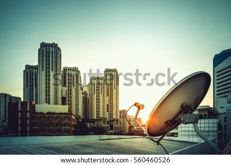 Satellite dish in sunset city building background
