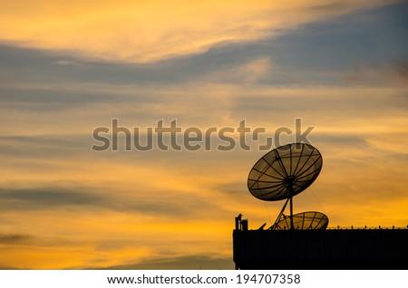 Satellite dish in twilight at sunset. - stock photo