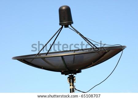 Satellite dish on blue sky - stock photo