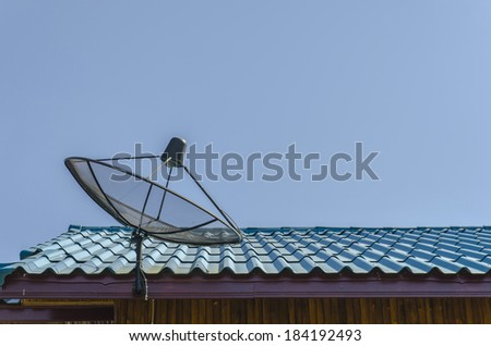 Satellite dish on blue sky background