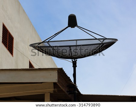 Satellite dish on roof house in the day