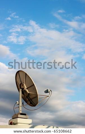 Satellite dish on sky - stock photo