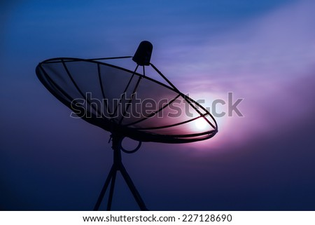 Satellite Dish on the Roof at Sunrise. - stock photo