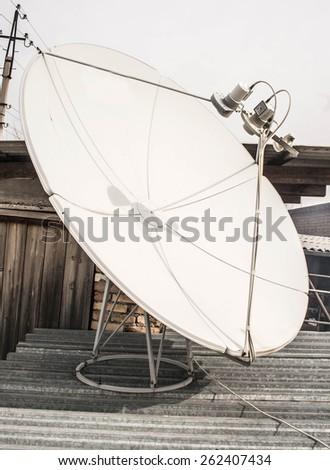 satellite dish on the roof, white - stock photo