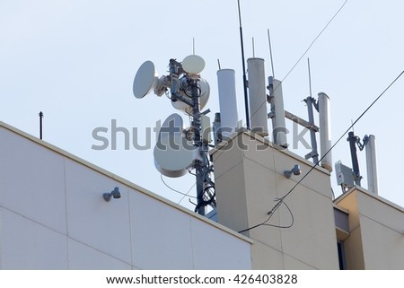 satellite dish repeaters on the building roof in the city