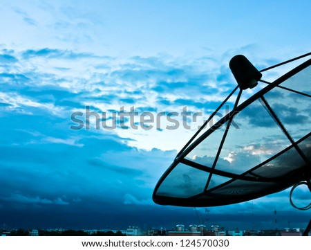 Satellite dish to the sky in the evening - stock photo