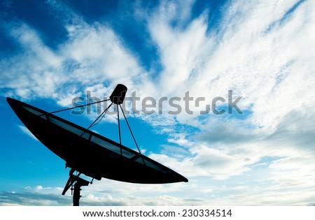 Satellite dish transmission data on background blue sky - stock photo