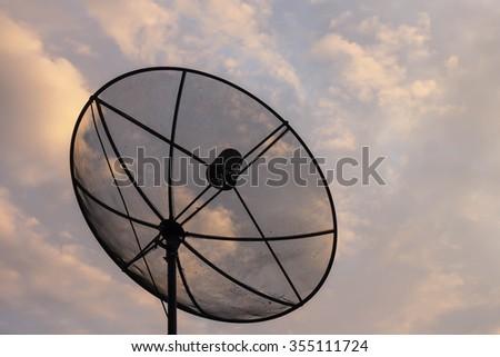 Satellite dish transmission data on background evening sky. - stock photo
