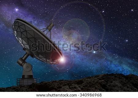 satellite dish under a starry night sky - stock photo