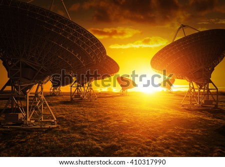 Satellite dish view during colorful sunset - stock photo