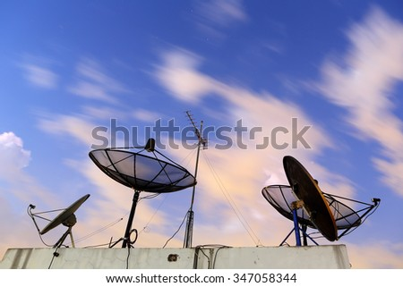 Satellite dish with communication technology network after moving clouds night - stock photo
