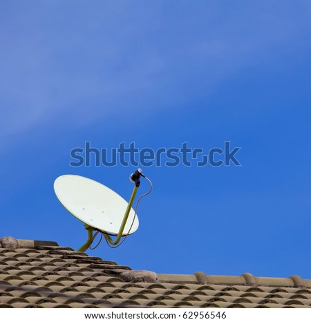 Satellite dish with sky on roof - stock photo