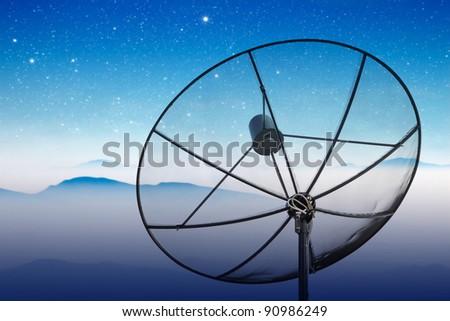 satellite dish with starry night sky - stock photo