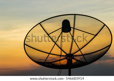satellite dish with sunlight and blue sky