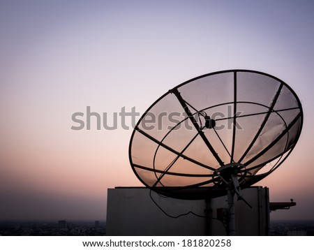 Satellite dish with sunset background