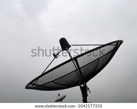 satellite dish with white cloud.