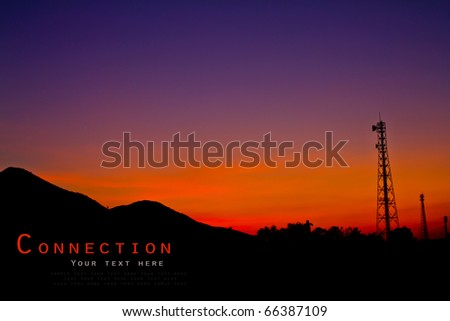 Satellite dishes and communications tower over sunset. - stock photo
