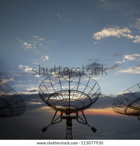 satellite dishes antenna with sunset