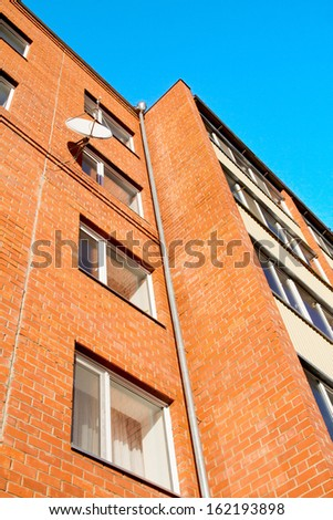 satellite dishes installed in brick houses - stock photo