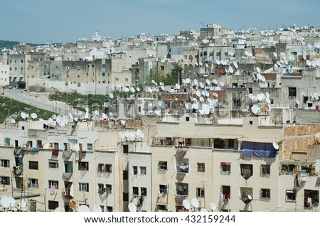 Satellite dishes on rooftops of houses in old town of Fes El Bali, Old Medina & UNESCO World Heritage Site - stock photo