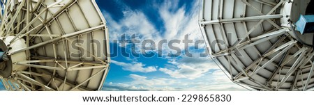 satellite dishs and sky - stock photo