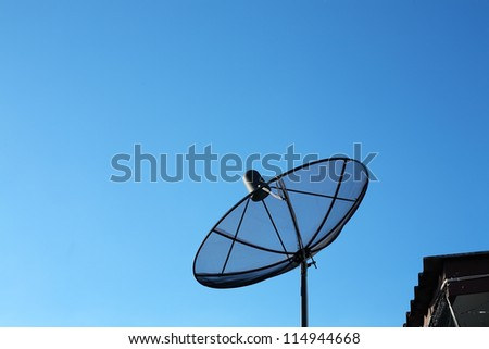 satellite disk against blue sky.