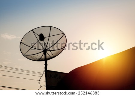 Satellite disk with sunset sky.