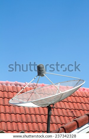 Satellite on the roof - stock photo