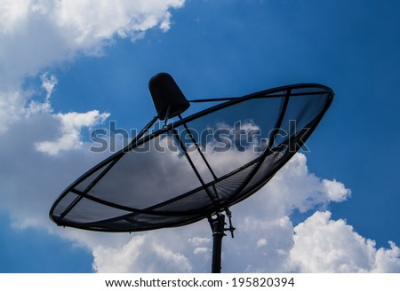 Satellite TV receiver on blue sky with cloud  background.