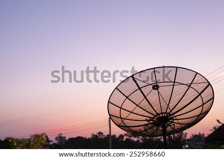 Satellite. TV tuner is installed on the roof. The sky in the morning warm - stock photo