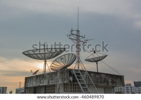Satellites on the building with sunset sky background