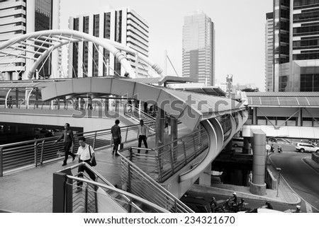 SATHORN ROAD, BANGKOK - NOV 21, 2014: High-Rise buildings and a sky walk at Sathorn-Narathiwas intersection in Bangkok,Thailand. Sky walk is the connecting walkway between sky train and rapid bus. - stock photo