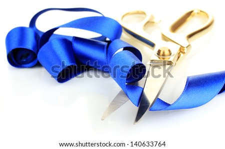 Satin ribbon curled around scissors isolated on white - stock photo