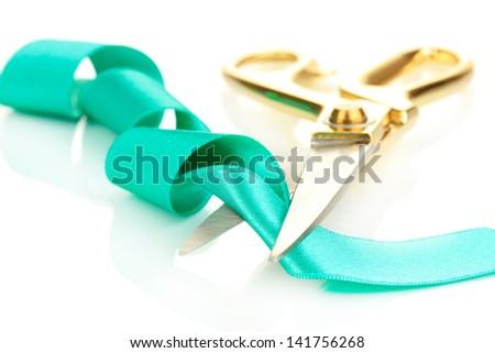 Satin ribbon curled around scissors isolated on white - stock photo