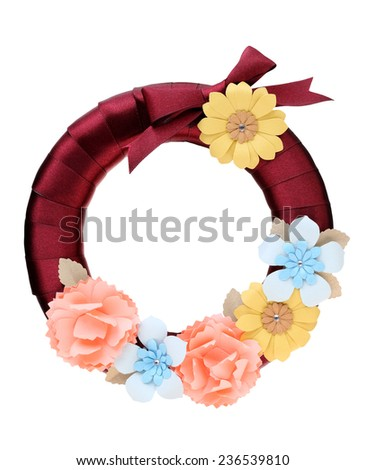 satin wreath decorated with handmade paper flower   - stock photo