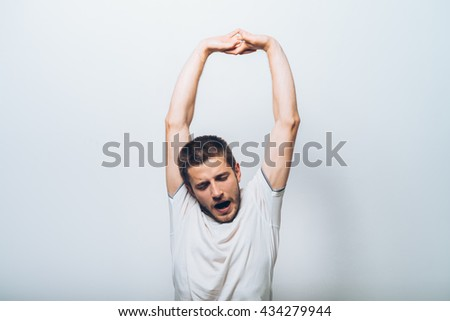 satisfaction and stretching hands man - stock photo