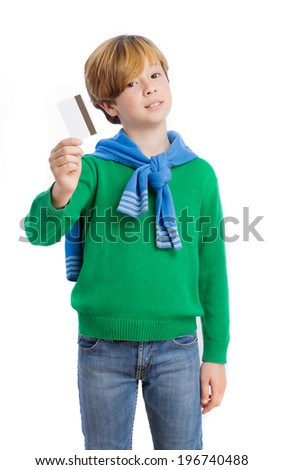 Satisfied boy holding a credit card - stock photo