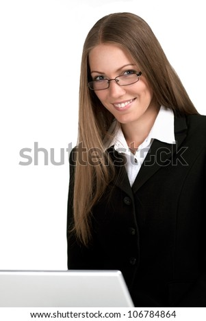 Satisfied businesswoman in front of a laptop