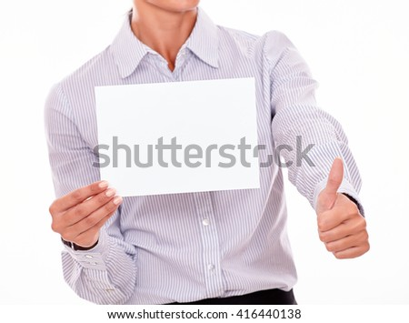 Satisfied businesswoman with a button down shirt, holding a blank signboard with one hand and a thumb up gesture with her left hand on a white background - stock photo