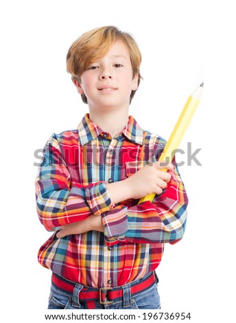 Satisfied child holding a pencil