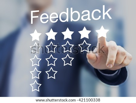 Satisfied customer pushing a five-star feedback rating button on a virtual interface application - stock photo