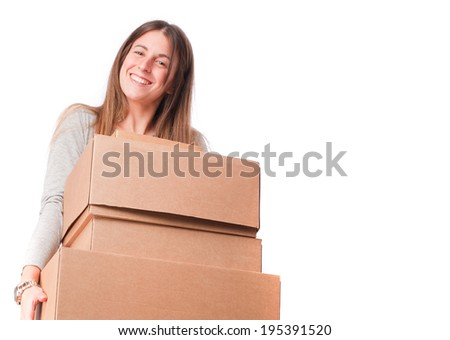 Satisfied girl holding a cardboard boxes - stock photo