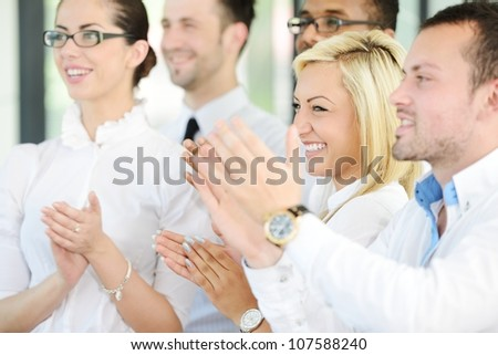 Satisfied group in business meeting - stock photo