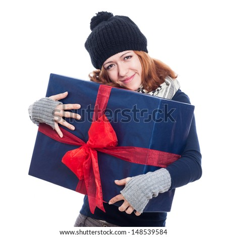 Satisfied happy winter woman holding big present, isolated on white background. - stock photo